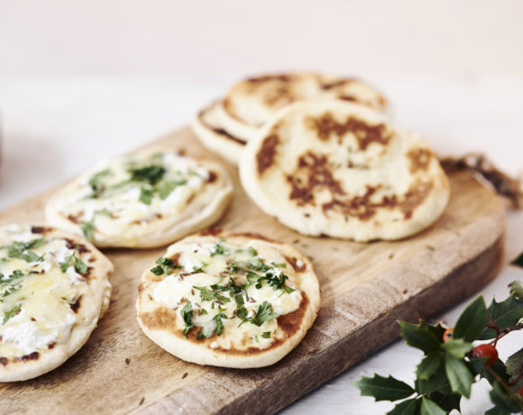 Appetizer naan with cheese and herbs