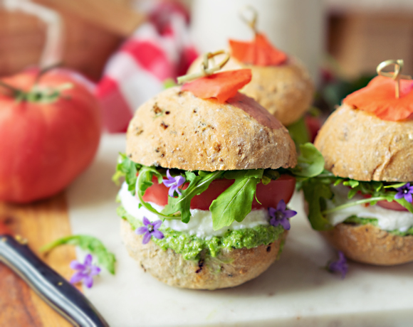 Pure Sprouts picnic burgers with pesto, tomatoes, and rocket